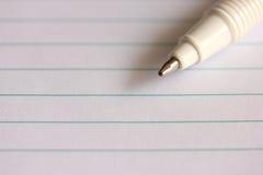 Ручка на тетради стоковые изображения rf