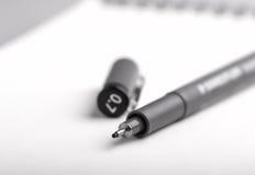 Ручка чертежа дальше пока предпосылка Стоковые Изображения RF