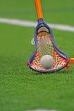 ручка lacrosse мальчиков Стоковая Фотография RF