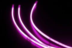 Ручки зарева пурпура на черной поверхности Стоковая Фотография RF