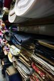 Рулоны ткани на шкафе Стоковое Изображение