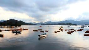 Рыбацкие лодки на озере Стоковые Изображения