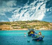Рыбацкие лодки приближают к деревне Marsaxlokk Стоковое Фото