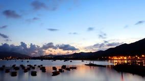 Рыбацкие лодки с отражением захода солнца Стоковые Фото