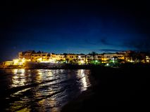 Рыбацкий поселок на ноче Стоковое Фото