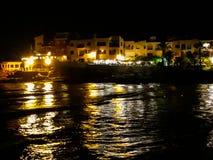 Рыбацкий поселок на ноче Стоковые Изображения