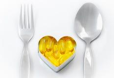 Рыбий жир на сердце как главным образом меню Стоковые Фото