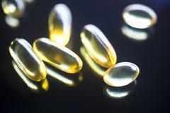 Рыбий жир capsules дополнение здоровой еды Стоковые Фотографии RF