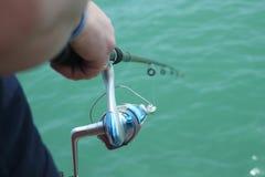 Рыбная ловля в зеленом озере в Турции стоковые фотографии rf