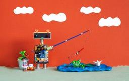 Рыбная ловля и воссоздание робототехнические Игрушка робота рыболова уловила большую рыбу Приманка ведра штанги аксессуаров рыбол стоковые изображения rf