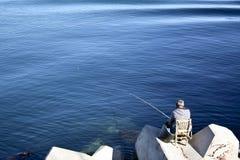Рыбная ловля старика в Валенсии, Испании Стоковые Изображения RF