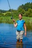 Рыбная ловля девушки на реке Стоковое фото RF