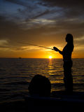 Рыбная ловля женщины от шлюпки вдоль побережья мексиканского залива Стоковые Фото