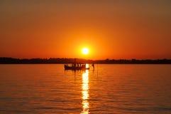 Рыбная ловля захода солнца Стоковое Изображение