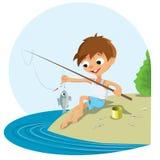 Рыбная ловля мальчика в реке Стоковая Фотография