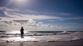 Рыбная ловля пляжа Стоковое Изображение RF