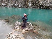 Рыбная ловля ребенк в реке Тары Стоковые Фотографии RF