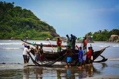 Рыбная ловля фотографии пляжа Стоковое Изображение RF
