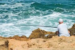 Рыбная ловля человека Стоковая Фотография