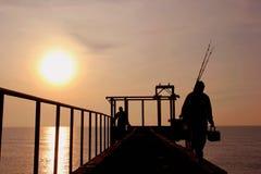 Рыбозаводы subtidal и заход солнца Стоковое Изображение