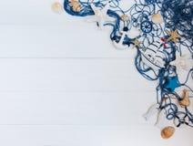 Рыболовная сеть с украшениями морских звёзд и моря стоковое фото