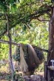 Рыболовные сети суша на пляже Деревня рыболовов на Бали стоковое изображение