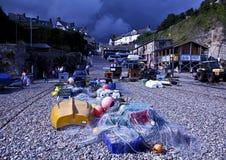 рыболовство заваривать пива над селом шторма Стоковое Изображение