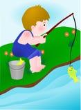 рыболовство мальчика Стоковая Фотография