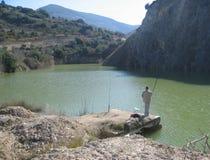 Рыболовство человека на озере Стоковое фото RF
