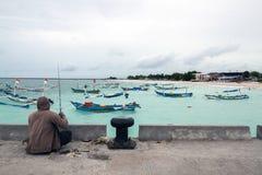 Рыболовы на пляже Jimberan стоковое изображение rf