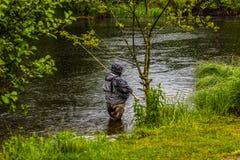 Рыболов в дожде Стоковая Фотография