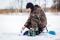 Рыболов льда на озере зимы Стоковое фото RF
