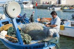 Рыболов на работе Стоковые Изображения