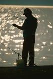 Рыболов на стыковке Стоковая Фотография RF