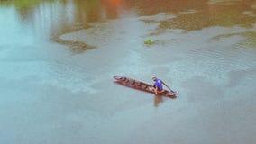 рыболов на шлюпке стоковая фотография