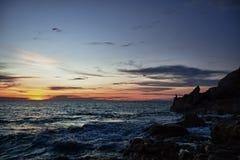 рыболов трясет заход солнца моря Стоковое фото RF