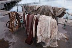 Рыболовная сеть на пристани Стоковые Изображения