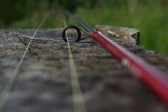 Рыболовная удочка на древесине Стоковые Фотографии RF