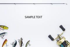Рыболовные принадлежности на белой предпосылке Стоковая Фотография RF