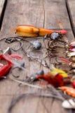 Рыболовные снасти и ложка на деревянном Стоковая Фотография