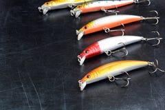 Рыболовные снасти - крюки и Wobblers на предпосылке Стоковая Фотография RF
