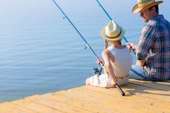 Рыболовство отца и дочи Стоковая Фотография RF