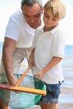 Рыболовство отца и сына стоковые фотографии rf