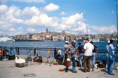 Рыболовство Стамбул. Башня Galata в предпосылке Стоковая Фотография RF
