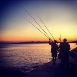 Рыболовы в заходе солнца Стоковые Фото
