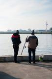 Рыболовы в порте весны Стоковые Фотографии RF