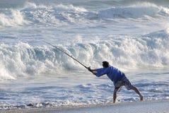 Рыболов бросая  Стоковые Изображения RF
