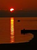 Рыболов в заходе солнца Стоковые Изображения RF