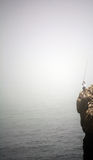 Рыболов в скале Стоковая Фотография