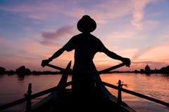 Рыболов захода солнца Стоковые Фотографии RF